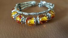 Amber coloured bangle set in white metal