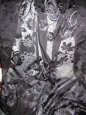 Tissu Voile brocart  brodé noir et doré   en 105 cm de large au mètre