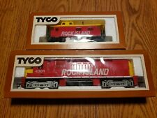 TYCO HO Scale Rock Island Diesel dummy with caboose. MIB's