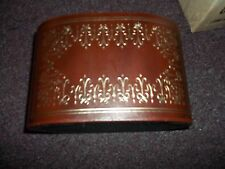 vintage leather looking holder with goldlike detail 5 inch high x8 inch long