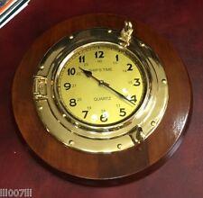 Grande orologio Navale in ottone a forma di oblò con base in legno