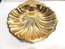 Brass colored metal shell shaped bowl or dish