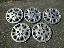 Five genuine 2002 to 2005 Saturn L series bolt on 15 inch hubcaps wheel covers