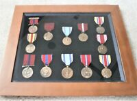 US Military Good Conduct Medal group of 12, framed