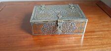 Antique Cairo ware bronze cigarette box with silver and copper inlay