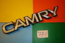 CLASSIC TOYOTA CAMRY BLACK, CHROME & CREAM PLASTIC BADGE EMBLEM. 145mm x 24mm