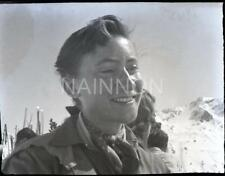 2 Small format negatives - FEMALE SKIER head & shoulders and reclining on rocks