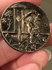 """Antique """"Cupid At The Fountain"""" Brass Button in the BB about 1&1/2"""""""