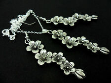 A TIBETAN SILVER FLOWER THEMED NECKLACE AND  EARRING SET. NEW.