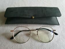 Gentle Monster silver round glasses frames.