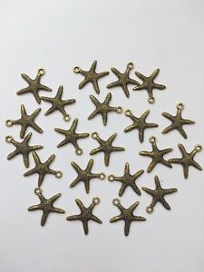 20 x Small Gold Starfish Charms Embellishment Card Craft Earrings Pendant