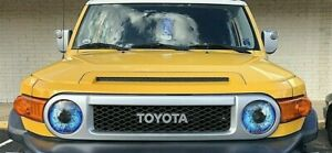 Toyota FJ cruiser  BLUE eyes headlight covers RuKindCovers Must have!