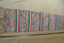 vintage handmade rag rug in green, blue, white and red with fringe full color