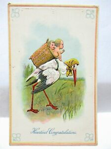 1910 POSTCARD HEARTIEST CONGRATULATIONS STORK WITH BASKET OF BABIES ON BACK