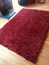 Deep pile, hand tied wool rug, shades of red from John Lewis