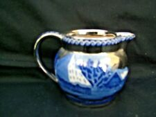 Wedgwood of Etruria & Barlaston cream jug Fallow Deer with silver ground