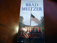 "THE FIFTH ASSASSIN BY BRAD MELTZER A PAPER BACK BOOK IT Measures 4 1/8"" X 7 1/4"""