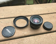 Nikon 20mm 2.8 D AF lens with caps and hood