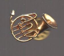 Pin's instrument musique trombone doré / relief