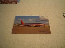 USAIR AIRLINES POSTCARD, BOEING 737-3B7, ON TARMAC IN INDIANAPOLIS, IND