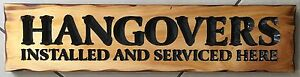 HANGOVERS Installed & Serviced Here Rustic Pine Timber Sign