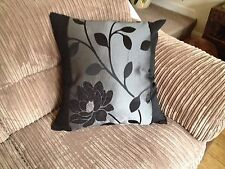 "4 22"" x 22"" Black And Silver cushion covers."