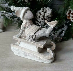 Adorable Christmas Mouse Sitting On Sledge With A Bird Ornament
