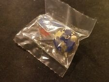 The world globe with shooting star excellence Lapel Pin NIB