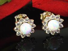 333 Gold  Ohrstecker 1 Paar 8 mm Grösse mit  Opalen