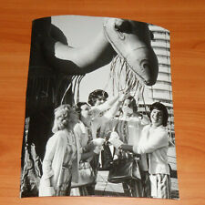1961 Press Photo Miami Orange Bowl Parade Young Ladies Stand Under Camel Float