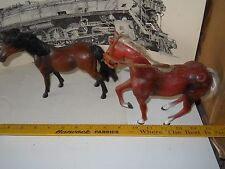2 Plastic horses approx 6 inches tall with manes & tails