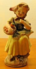 vintage norleans girl figurine with oranges in basket