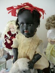antique Black baby toddler character sit on the sheep with Easter basket