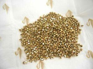 140 Swarovski Bicone crystal beads in 4mm Aurum coated 2x. #5301