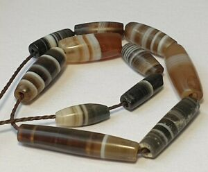 11 ANCIENT RARE INDO TIBETAN BANDED AGATE TUBE BEADS