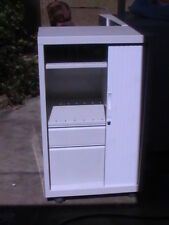 Tambour cabinet with filing drawer, shelves and hanging space 80Wx50Dx105H