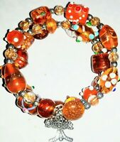 Memory Wire Bracelet with Orange Glass Beads  Charms on ends FREE SHIPPING