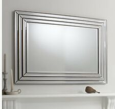 Contemporary inspired Wall mirror with a double step frame in a bronze finish