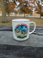 Vintage Mount Rushmore South Dakota souvenir mug gold trim small with mountain