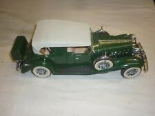 A Danbury mint of a scale model of a 1932 Cadillac V16 Phaeton