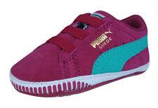 Premières chaussures roses pour bébé