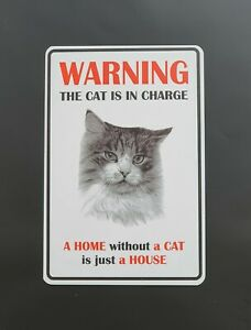 WARNING. THE CAT IS IN CHARGE  SIGN