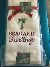Two New Palm Tree Beach Christmas TOWELS Reads SEAS AND GREETINGS.