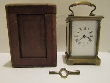 Early 20th century brass carriage clock with key and original case, working