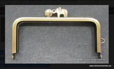 Boquilla monedero oro viejo cierre elefante ( producto ubicado en cajón 31-AB)