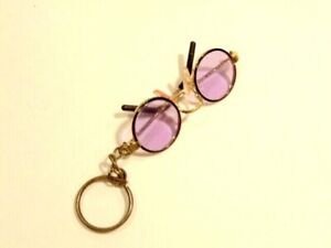 unusual pre-owned key chain attached to small pair of blue tinted eye glasses