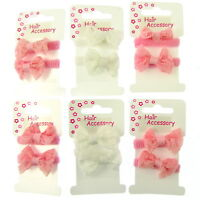 PACK OF 4 BOW PONIOS AND 9 PRINTED ELASTICS IN HEARTS OR FLOWERS