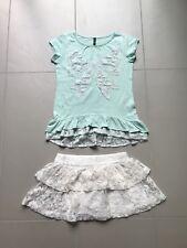 Beneton ensemble 2 pièces jupe et t shirt taille S  - 120 (6-7 ans)