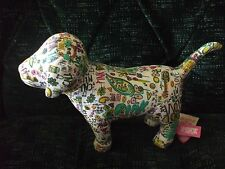 victoria secret pink, multi-colored dog