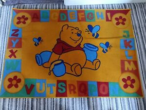 Winnie the Pooh kids rug (yellow, alphabet)